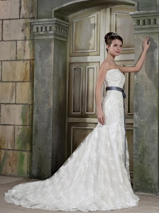 Romantic Trumpet/Mremaid Strapless Court Train Lace Sash / Ribbons Wedding Dress