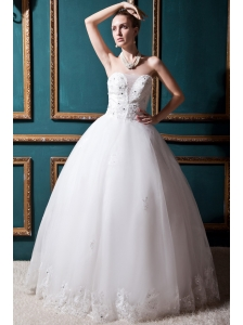 Luxurious Ball Gown Strapless Floor-length Tulle Beading Wedding Dress