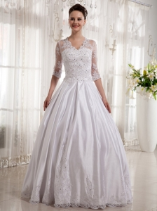 Lace and Beading Long Sleeves V-neck Wedding Dress With Floor-length