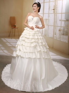 Sweetheart Neckline Ivory Satin Wedding Desss With Ruffled Layers and Beaded Decorate