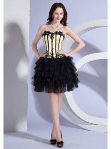 Appliques Decorate Bodice Light Yellow and Black Knee-length Ruffled Layers 2013 Prom Dress