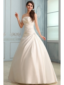A-Line Strapless Floor-length Beading Lace Up Wedding Dress in Champagne