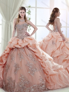 Elegant Brush Train Peach Quinceanera Gown with Appliques and Bubbles