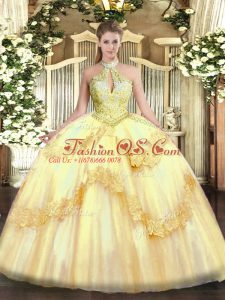 Gold Ball Gowns Tulle Halter Top Sleeveless Appliques and Sequins Floor Length Lace Up 15th Birthday Dress