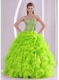 Best Seller Spring Green Sweetheart Ruffles and Beading Cute Quinceanera Dresses,Breathtaking in extreme, this strapless ball gown is sure to get you noticed! Richly beading abounds the fitted bodice with refined boning details and modest sweetheart. An oversize rosette blooms along the top of the densely ruffled skirt, which flares boldly to the floor. A lace up corset style closure in the back secures the dress in place. There's just something about vintage-inspired gowns that no other style can duplicate.