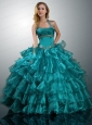 2015 Luxurious Halter Top Teal Quinceanera Dresses with Ruffled Layers
