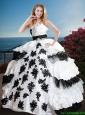 2016 Fashionable Black and White Quinceanera Dress with Appliques and Ruffled Layers