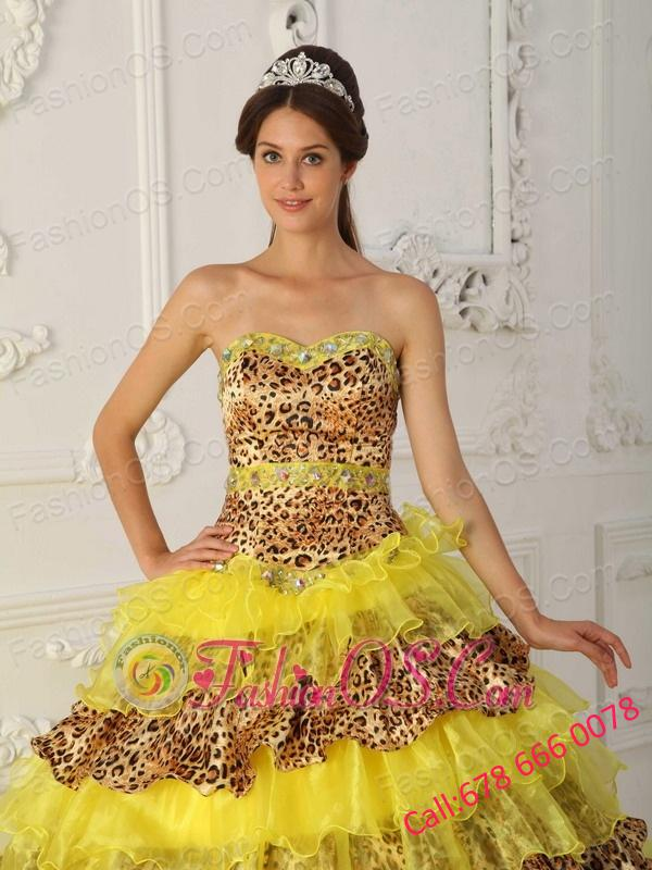 424c85c54a ... The Most Popular Yellow Quinceanera Dress Strapless Sweep  Brush Train  Leopard and Organza Ruffles A ...