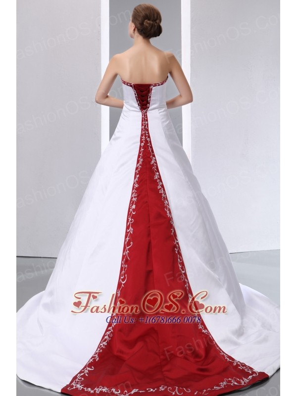 Luxurious Wedding Dress A-line Embroidery With Beading Strapless Chapel Train Satin