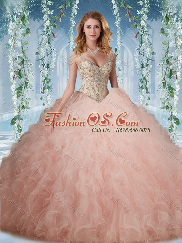 Unique Deep V Neck Peach Quinceanera Dress With Beading and Ruffles